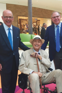 A. Alfred Taubman enjoys a moment with his sons Robert and Willi